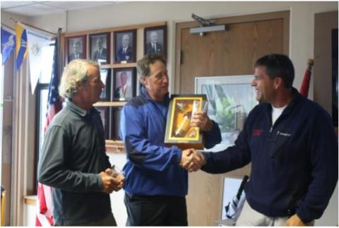Brian Tyrell presents Dale Dunning and Eric Taylor with the customary bottle of scotch to the Pacific District Champion which was shared with all.