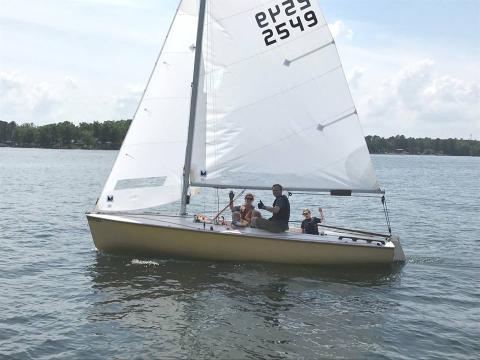 The Phinneys show us family sailing at its best. Nate (Dad), when responding to our request for impressions of his Make Your Scot Fly experience, said his son liked best that his name was on the MYSF completion certificate along with Mom and Dad.